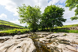 © Licensed to London News Pictures. 12/06/2018. Stonehouse UK. A stretch of the River Dee is running very low of water in  Stonehouse in the Yorkshire Dales due to the recent lack of rain causing fears of a possible drought. Britain could be heading for a three month heatwave with temperatures hitting 29c by July. Photo credit: Andrew McCaren/LNP