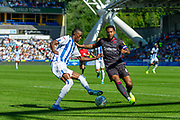 Reading captain Liam Moore with Huddersfield Town Adama Diakhaby during the EFL Sky Bet Championship match between Huddersfield Town and Reading at the John Smiths Stadium, Huddersfield, England on 24 August 2019.