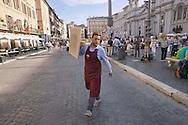 Roma 6 Agosto 2014<br /> Sono tornati per pochi minuti i dehors a Piazza Navona. I titolari dei ristoranti  hanno deciso di alzare le saracinesche e ripristinare gli spazi esterni, ma posizionando i tavolini nel rispetto dei limiti imposti dalle concessioni del comune di Roma. Ma gli agenti della municipale li hanno bloccati: &quot;Non sono autorizzati&quot;. Un cameriere con un tavolo del ristorante chiuso<br /> Rome August 6, 2014 <br /> They came back for a few minutes the dehors in the Piazza Navona. The owners of the restaurants have decided to raise the  rolling shutter and restore the dehors, but by placing the tables within the limits imposed by the concessions of the city of Rome. But the agents of the municipal blocking them: &quot;They are not unauthorised &quot;. A waiter with a table of the restaurant closed