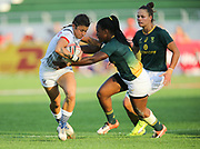 DUBAI, UNITED ARAB EMIRATES - Thursdays 30 November 2017, Nicole Heavirland of the USA is tackled by Zintle Mpupha of South Africa during HSBC Emirates Airline Dubai Rugby Sevens match between South Africa and the USA at The Sevens Stadium in Dubai.<br /> Photo by Roger Sedres/ImageSA