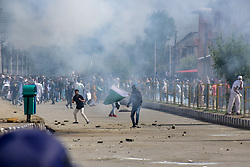 June 16, 2018 - Srinagar, Jammu & Kashmir, India - Kashmiri protesters Clashes with the police and paramilitary soldiers during clashes after the culmination of Eid-ul-Fitr congregational prayers in Srinagar summer capital of Indian Held Kashmir on Saturday..Government Forces in Indian Administered Kashmir used tear gas and pellet guns to disperse hundreds of stone-throwing protesters who took to the streets after Eid al-Fitr prayers protesting against Indian rule on Saturday. (Credit Image: © Abbas Idrees/SOPA Images via ZUMA Wire)