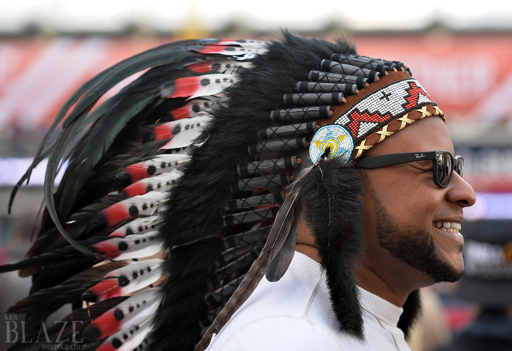 Oct 25, 2016; Cleveland, OH, USA; Cleveland Indians fan Darryl Willis wears a head dress before game one of the 2016 World Series against the Chicago Cubs at Progressive Field. Mandatory Credit: Ken Blaze-USA TODAY Sports