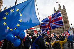 © Licensed to London News Pictures. 05/12/2018. London, UK. Pro-Brexit and Anti-Brexit demonstrators campaign next to each other outside parliament. This week MPs are debating the withdrawal deal ahead of a vote on the 11 December. Photo credit : Tom Nicholson/LNP