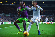 Niclas Eliasson of Bristol City (19) and Barry Douglas of Leeds United (3) come together during the EFL Sky Bet Championship match between Leeds United and Bristol City at Elland Road, Leeds, England on 24 November 2018.