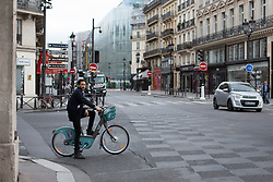 Cyclist on a velib on Rivoli Street in Paris on May 4, 2020, on the forty-ninth day of a strict lockdown in France, in place to attempt to stop the spread of the new coronavirus (COVID-19). Photo by Raphael Lafargue/ABACAPRESS.COM