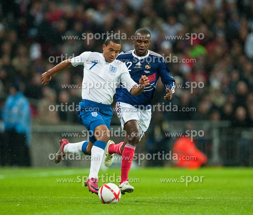 17.11.2010, Wembley Stadium, London, ENG, Freundschaftliches Laenderspiel, England vs Frankreich, im Bild England's Theo Walcott in action against France's Eric Abidal// during the International Friendly match England vs France in London at Wembley Stadium on 17/11/2010, EXPA Pictures © 2010, PhotoCredit: EXPA/ Propaganda/ D. Rawcliffe *** ATTENTION *** UK OUT!