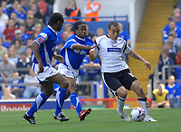 Photo: Ashley Pickering.<br /> Ipswich Town v Derby County. Coca Cola Championship. 14/04/2007.<br /> Craig Fagan of Derby (R) tries to get past Jaime Peters and Fabian Wilnis (L)