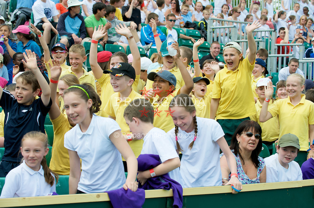 LIVERPOOL, ENGLAND - Tuesday, June 16, 2009: School children cheer on the players during Kids Day at the Tradition ICAP Liverpool International Tennis Tournament 2009 at Calderstones Park. (Pic by David Rawcliffe/Propaganda)