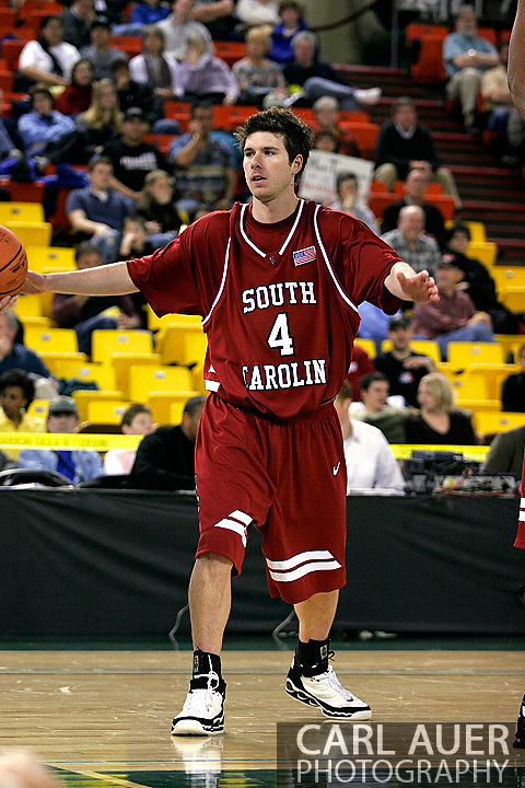 24 November 2005:Junior guard/forward Bryce Sheldon from the University of South Carolina defends a inbound pass in the Gamecock's 65 - 60 victory over the University of Alaska Anchorage Seawolves in the first round of the Great Alaska Shootout at the Sullivan Arena in Anchorage Alaska.