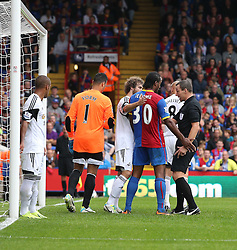 Referee K Friend speaks to Crystal Palace's Cameron Jerome and Swansea City's José Alberto Canas - Photo mandatory by-line: Robin White/JMP - Tel: Mobile: 07966 386802 22/09/2013 - SPORT - FOOTBALL - Selhurst Park - London - Crystal Palace V Swansea City - Barclays Premier League