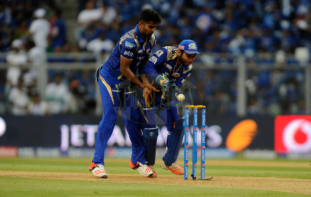 Vinay Kumar of Mumbai Indians and Parthiv Patel of Mumbai Indians try to collect a ball during match 23 of the Pepsi IPL 2015 (Indian Premier League) between The Mumbai Indians and The Sunrisers Hyferabad held at the Wankhede Stadium in Mumbai India on the 25th April 2015.<br /> <br /> Photo by:  Pal Pillai / SPORTZPICS / IPL