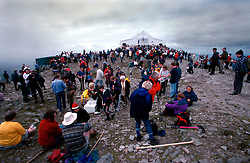 IRELAND CO. MAYO CORAGH PATRICK JUL99 - Pilgrims gather around the chapel on top of Croagh Patrick mountain in western Ireland. Around 25,000 people, some of which are bare-footed, participate in this pilgrimage to the top of Croagh Patick mountain on the last Sunday of July from where in 441 A.D. St. Patrick supposedly sent Ireland's reptiles to their doom. ..jre/Photo by Jiri Rezac..© Jiri Rezac 1999..Contact: +44 (0) 7050 110 417.Mobile: +44 (0) 7801 337 683.Office: +44 (0) 20 8968 9635..Email: jiri@jirirezac.com.Web: www.jirirezac.com..© All images Jiri Rezac 1999 - All rights reserved.