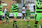 FGR Ambassador with Forest Green Rovers Charlie Cooper(20) during the Vanarama National League match between Forest Green Rovers and Boreham Wood at the New Lawn, Forest Green, United Kingdom on 11 February 2017. Photo by Shane Healey.