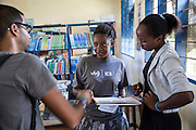 Francisca Mlingwa and other ICS volunteers discuss plans before working with students at Angaza school as part of the VSO / ICS Elimu Fursa project (Opportunities in Education) Lindi, Lindi region. Tanzania.