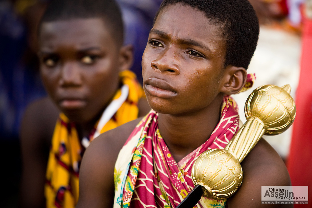 A young boy holds a ceremonial sword painted to look like gold during the annual Oguaa Fetu Afahye Festival in Cape Coast, Ghana on Saturday September 6, 2008.