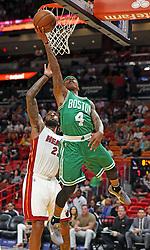 November 28, 2016 - Miami, FL, USA - The Miami Heat's Derrick Williams fails to stop the Boston Celtics' Isaiah Thomas in the first quarter on Monday, Nov. 28, 2016 at the AmericanAirlines Arena in Miami, Fla. (Credit Image: © Charles Trainor Jr/TNS via ZUMA Wire)