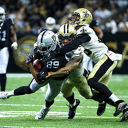 Sep 11, 2016; New Orleans, LA, USA;  Oakland Raiders wide receiver Amari Cooper (89) is tackled by New Orleans Saints linebacker James Laurinaitis (53) and cornerback P.J. Williams (25) during the second quarter of a game at the Mercedes-Benz Superdome. Mandatory Credit: Derick E. Hingle-USA TODAY Sports