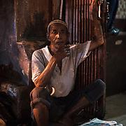 Man at Jakarta Kota station, Java, Indonesia