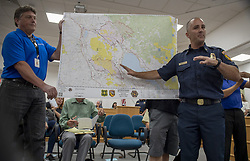 July 31, 2018 - Clearlake, California, U.S. - Cal Fire Battalion Chief JOHN MESSINA updates residents displaced by the two fires in Lake County, on Tuesday morning, July 31, 2018 at the Clearlake City Council Chambers. Mendocino Complex fires had burned 90,212 acres by Wednesday morning, Cal Fire said. (Credit Image: © Jose Luis Villegas/Sacramento Bee via ZUMA Wire)