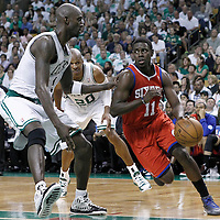 26 May 2012: Philadelphia Sixers point guard Jrue Holiday (11) drives past Boston Celtics power forward Kevin Garnett (5) during the Boston Celtics 85-75 victory over the Philadelphia Sixer, in Game 7 of the Eastern Conference semifinals playoff series, at the TD Banknorth Garden, Boston, Massachusetts, USA.