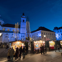 LJUBLJANA, SLOVENIA - DECEMBER 02: Locals and tourists walk along the Christmas market behing the main Cathedral on December 2, 2017 in Ljubljana, Slovenia. The traditional Christmas market and lights will stay until 1st week of January 2018. (Photo by Marco Secchi/Getty Images)