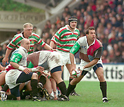1997 Heineken European Cup, Stoop 18-4-98 Chris Sheasby distributes the ball from the ruck Quins Keith Wood [left ] Tigers's Neil Back and right Graham Rowntree, [Mandatory Credit, Peter Spurrier/ Intersport Images]