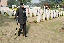 © Licensed to London News Pictures. 11/11/2012. Delhi, India. An Indian World War veteran walks past graves at the Delhi War Cemetery, Delhi, India, where a Remembrance Day ceremony was held today. Remembrance Day (also known as Poppy Day or Armistice Day) is a memorial day observed in Commonwealth countries since the end of World War I to remember the members of their armed forces who have died in the line of duty. This day, or alternative dates, are also recognized as special days for war remembrances in many non-Commonwealth countries. Remembrance Day is observed on 11 November to recall the end of hostilities of World War I on that date in 1918.   Photo credit : Richard Isaac/LNP