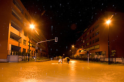 Two guys with a surfboard in the middle of street full of water after heavy rain on September 18, 2010, in Ljubljana, Slovenia. (Photo by Matic Klansek Velej / Sportida)