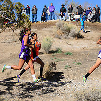 110114       Cable Hoover<br /> <br /> Miyamura Patriot Chanel Scott, right, leads the race into the first climb at the  district cross country meet at the Fox Run Golf Course in Gallup Saturday.