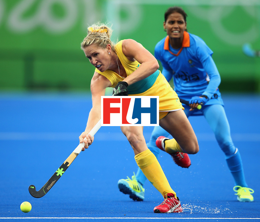 RIO DE JANEIRO, BRAZIL - AUGUST 10:  Jodie Kenny of Australia is watched by Vandana Katariya of India during the Women's Pool B Match between India and Australia on Day 5 of the Rio 2016 Olympic Games at the Olympic Hockey Centre on August 10, 2016 in Rio de Janeiro, Brazil.  (Photo by Mark Kolbe/Getty Images)