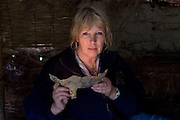 SAVEOCK WATER, CORNWALL, ENGLAND - AUGUST 03: A portrait of archaeologist Jacqui Wood on August 3, 2008 in Saveock Water, Cornwall, England. Inside her replica Bronze Age Roundhouse she is holding a fragment of an iron cauldron found in a votive pool which she dates between the medieval period to the 17th century (no carbon dating)(Photo by Manuel Cohen) / Epicureans Photographers