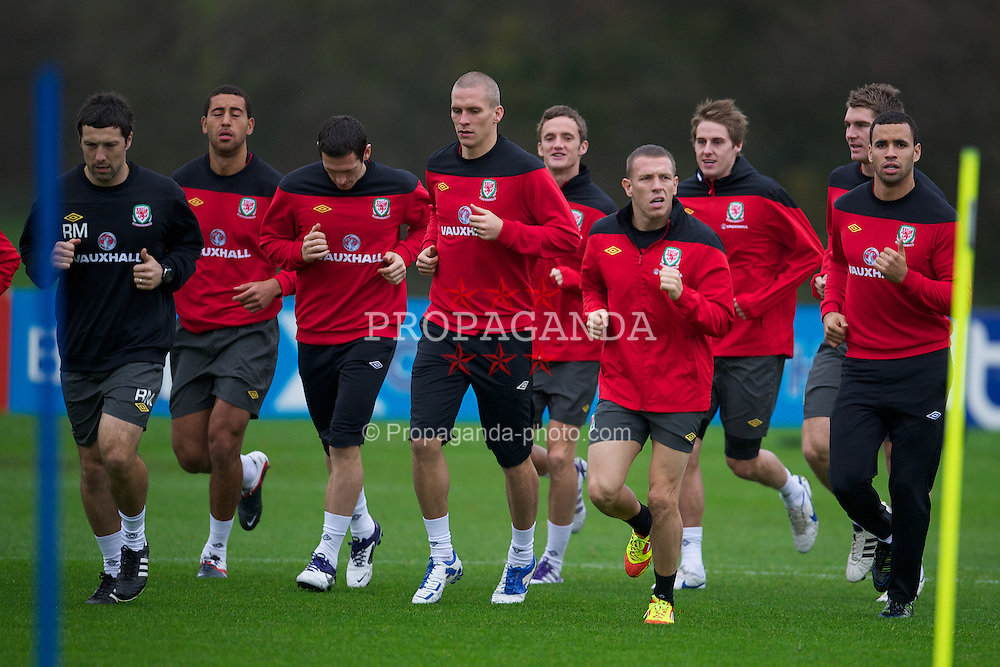 CARDIFF, WALES - Wednesday, November 9, 2011: Wales players during a training session at the Vale of Glamorgan Hotel ahead of the friendly match against Norway. L-R: fitness coach Ryland Morgans, Lewin Nyatanga, Steve Morison, Andy King, Craig Bellamy, David Edwards, Sam Vokes, Hal Robson-Kanu. (Pic by David Rawcliffe/Propaganda)