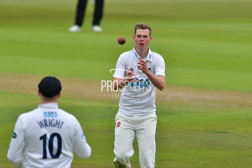 Luke Wright throws debutant Adam Barton the ball during the Specsavers County Champ Div 2 match between Nottinghamshire County Cricket Club and Sussex County Cricket Club at Trent Bridge, West Bridgford, United Kingdon on 21 April 2017. Photo by Simon Trafford.
