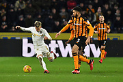 Leeds United midfielder Ezgjan Aioski (10) and Hull City defender Michael Hector (5) during the EFL Sky Bet Championship match between Hull City and Leeds United at the KCOM Stadium, Kingston upon Hull, England on 30 January 2018. Photo by Ian Lyall.