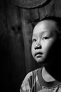 Kaili, Guizhou, China, August 10th 2007: Portrait of a 6 year old Miao boy..Photo: Joseph Feil