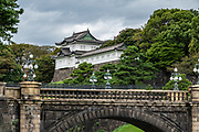 Tokyo Imperial Palace and Garden, the current residence of Japan's Imperial Family. The current Imperial Palace is on the former site of Edo Castle, a large park area surrounded by moats and massive stone walls in the center of Tokyo, a short walk from Tokyo Station. Edo Castle was formerly the seat of the Tokugawa shogun who ruled Japan from 1603-1867. In 1868, the shogunate was overthrown, and the country's capital and Imperial Residence were moved from Kyoto to Tokyo. In 1888 construction of a new Imperial Palace was completed. The palace was once destroyed during World War Two, and rebuilt in the same style, afterwards.
