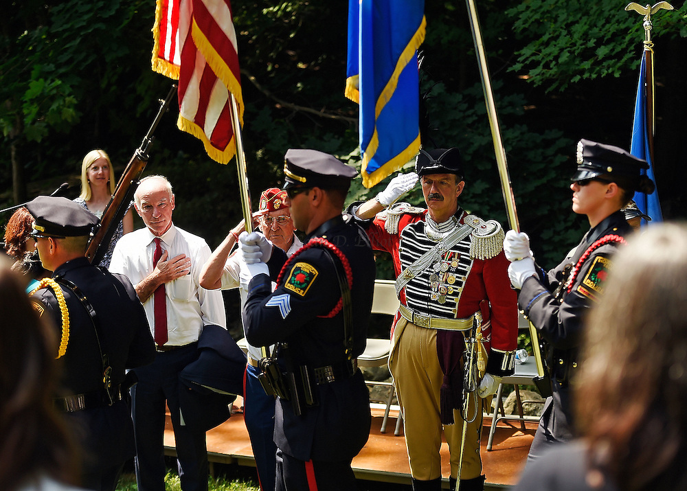 7/1/16 :: REGION :: BESSETTE :: U.S. Congressman Joe Courtney (D-Conn.), left, William Sullivan of the Thames River Detachment, Post #1334, of the Marine Corps League, center, and Major Mark Boudreau, of the First Company Governor's Foot Guard, salute as the color guard from the Norwich Police Department retire the colors following the annual wreath-laying at the grave of Samuel Huntington Friday, July 1, 2016 at the Historic Norwichtown cemetery in Norwich. Huntington was a signer of the Declaration of Independence and served as first President of the United States under the Articles of Confederation, the governing documents that preceded the constitution. (Sean D. Elliot/The Day)