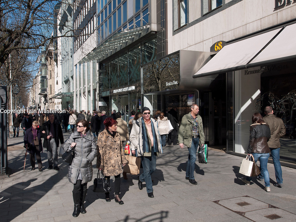 Crowds of shoppers on upmarket shopping street Konigsallee in Düsseldorf in  Germany