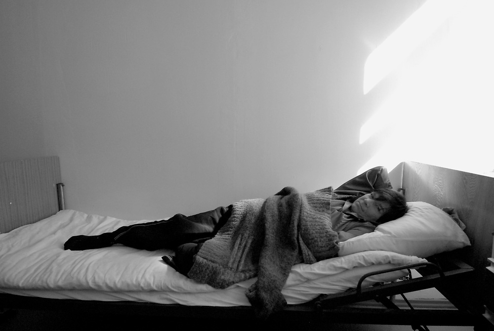 Russia. Tomsk (Siberia). 23.08.2007. TB Hospital. TB patient inside her room.