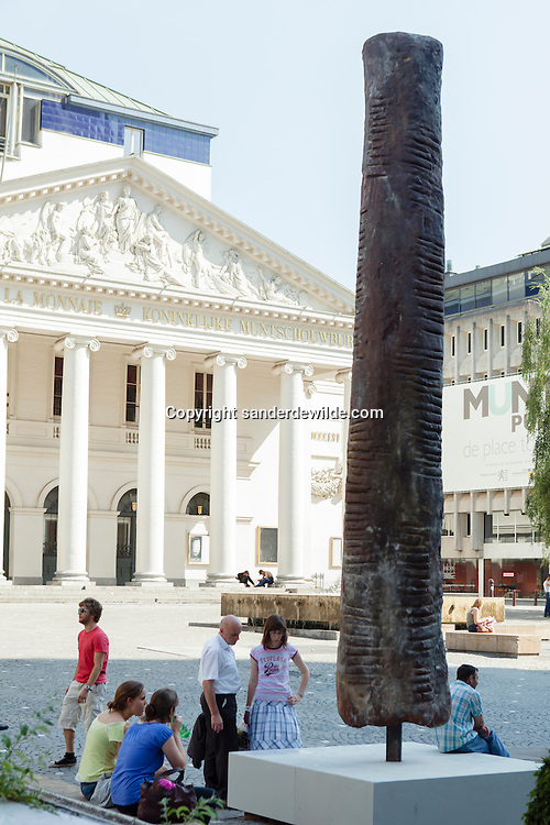 People admire this 7 meters high replica of the Ishango bone on the Munt Square in Brussels.The original carved bone, found by explorer Jean de Heinzelin de Braucourt in 1960 in the Belgian Congo, dates back 22.000 years, and is the first proof of mathematical knowledge of humans.