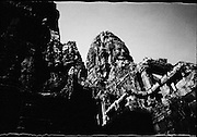 A giant stone face of Bayon towers over the temple complex.