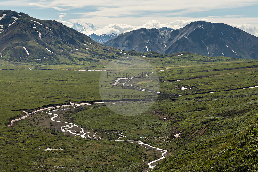 View of the Polychrome Hills and the Alaska Range and the offshoots of the Toklat River in Denali National Park Alaska. Denali National Park and Preserve encompasses 6 million acres of Alaska's interior wilderness.