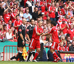 CARDIFF, WALES - SUNDAY, AUGUST 13th, 2006: Liverpool's Mark Gonzalez is substituted by Fabio Aurelio against Chelsea during the Community Shield match at the Millennium Stadium. (Pic by David Rawcliffe/Propaganda)