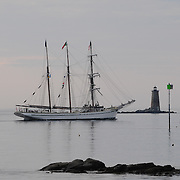 Tall ship Gazela passes by Whaleback Lighthouse off New Castle, NH as it heads out to sea after attending Sail Portsmouth 2011 in Portsmouth, NH