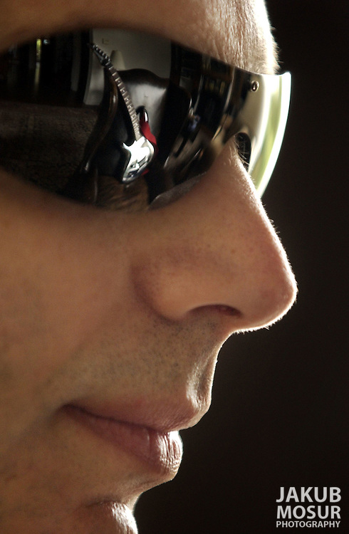 Joe Satriani's chrome guitar reflects off his glasses at his home in San Francisco on Wednesday, Feb. 12, 2003. (AP Photo/Jakub Mosur)