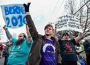 Supporters of Democratic presidential candidate Bernie Sanders protest outside a rally for Republican presidential candidate Donald J. Trump at Grumman Studios on Wednesday, April 6, 2016, in Bethpage, N.Y. (AP Photo/Kathy Kmonicek)