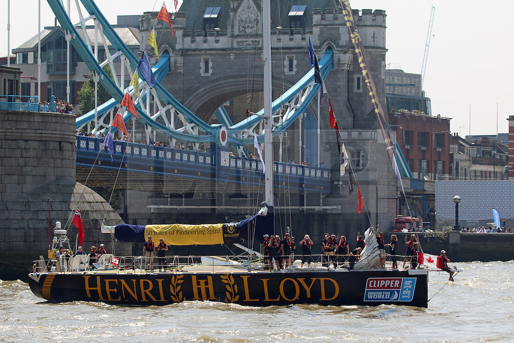 © Licensed to London News Pictures. 12/07/2014. The 12 yachts that took part in the Round The World Clipper Race have returned to London as their race draws to a close. The race started from London last summer and has taken competitors around the globe. The race was established in 1996 by Sir Robin Knox Johnston and allows anyone to sign up as a crew member under a professional captain. The yachts completed the final stage from Den Helder to Southend last night (11th July) and began their Parade of Sail up to St Katherine Docks this morning. The overall race winners were the Henri Lloyd crew. Credit : Rob Powell/LNP