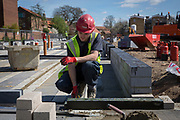 A builder using a section of Foamglas Perinsul HL for thermal insulation in the foundations of a new house on a home building construction site in Norwich. Norfolk. United Kingdom. (photo by Andrew Aitchison / In pictures via Getty Images)