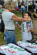 BRISTOL, PA -  SEPTEMBER 14:  Jackie Papeo holds up a tee shirt to her daughter Emily Papeo, 8 bot of Langhorne, Pennsylvania at the Italian Festival September 14, 2013 in Bristol, Pennsylvania. (Photo by William Thomas Cain/Cain Images)