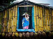 08 OCTOBER 2017 - KATUNAYAKE, WESTERN PROVINCE, SRI LANKA: A statue of the Virgin Mary and Baby Jesus in a bamboo niche above the entrance to a Catholic church in Katunayake, a community north of Colombo. About 8% of Sri Lanka is Christian, the majority of which are Roman Catholic. Catholicism was spread by Portuguese colonizers who came to Sri Lanka in the 1500 and 1600s.    PHOTO BY JACK KURTZ